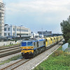 Yeoman branded Class 59 No.59002 rolls past the former EMI factory at Hayes with a rake of ARC hoppers<br /> <br /> 1995