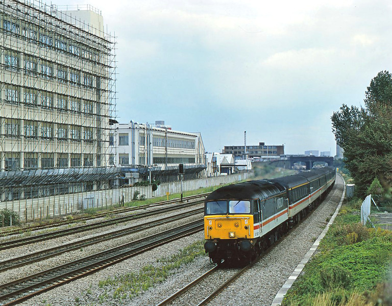 Inter City liveried 47807 storms past Hayes. This scene has long been lost with the introduction of OHLE and the Heathrow express<br /> <br /> 1995