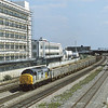 37894 is in charge of a rake of empty hoppers as it rolls past Hayes.<br /> <br /> 1995