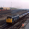 25037 passes Toton with what appears to be sheeted steel coils.<br /> 1978