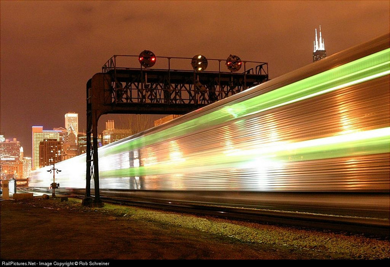 A Metra train rolls under the Pennsy style signal bridge on the north side of Chicago.