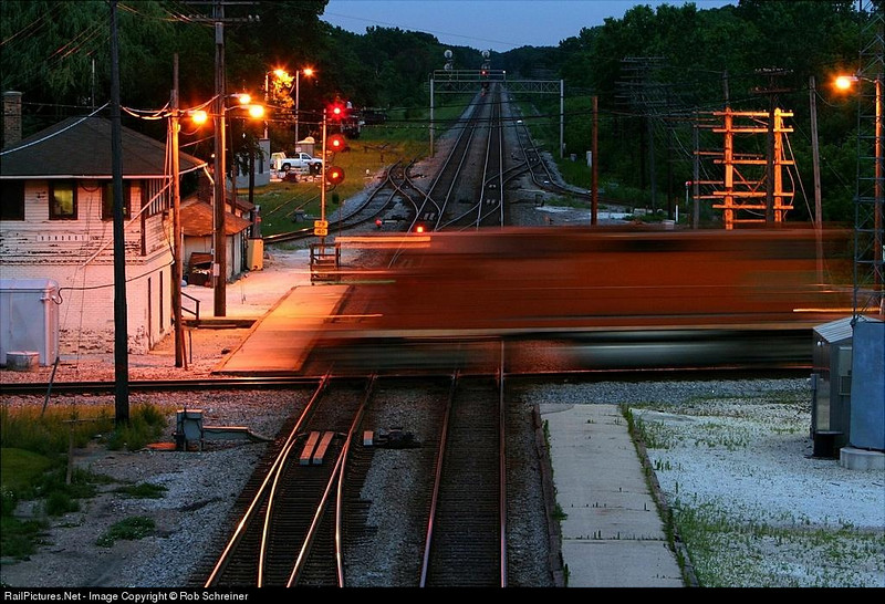 Another of my favorites, the EJ&E streaks across the CP Rail / Metra mainlines to deliver cars at Rondout tower.