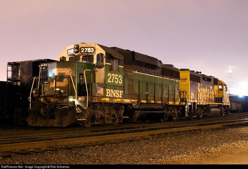 BNSF locomotives sit in Western Ave yard on a foggy night in Chicago.