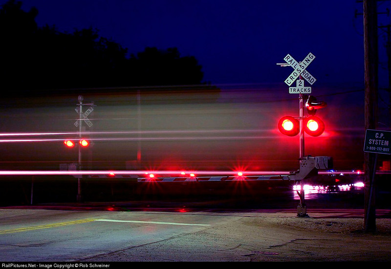 CP Rail's Rondout turn, G63 heads north thru the crossing at Wadsworth Rd. in Wadsworth, IL.