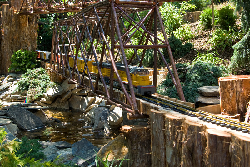 The trains make their way through streams and a waterfall.