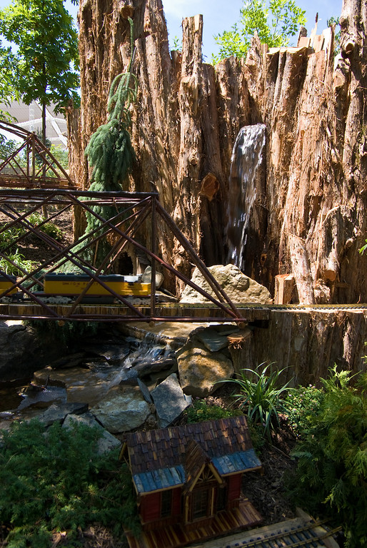The waterfall and tunnels are central features of the railroad.
