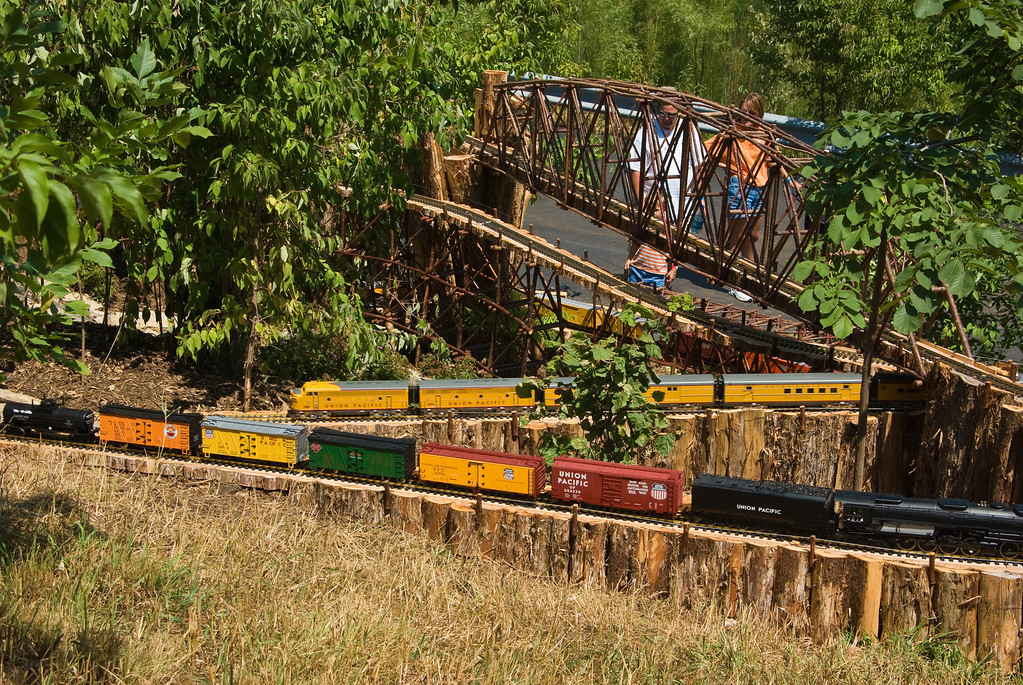 The garden railroad can be viewed from the rose garden.