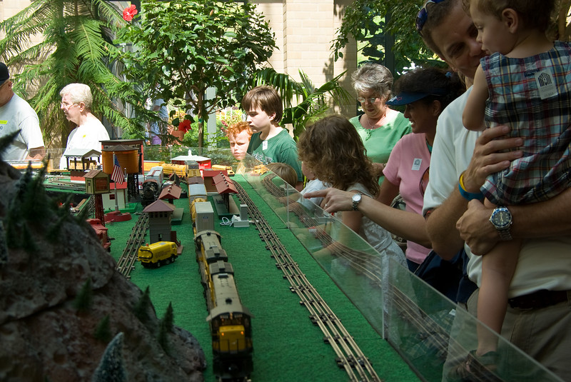 Kids of all ages watched these trains in air conditioned comfort.