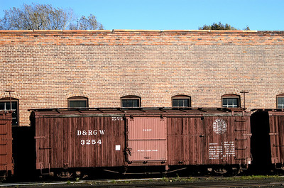 Former D&RGW boxcars next to enginehouse in Chama, New Mexico.