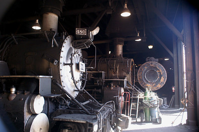 A couple of Durango & Silverton engines lit up by the morning sun in the Durango roundhouse.