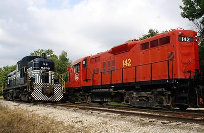 An odd couple.  New York Central #8255 & Missouri Kansas Texas #142 in Baldwin City, KS.