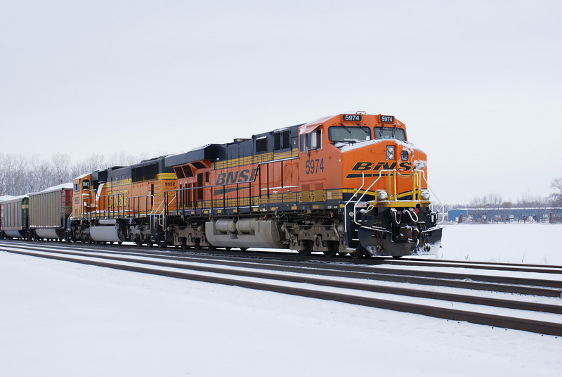 BNSF 5974 (GE ES44AC) and BNSF 9952 (EMD SD70MAC) idling at Wenz Road crossing, Toledo, OH @09:24 on 3/28/08