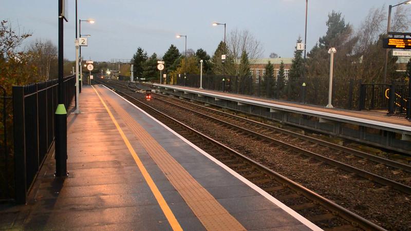 57313 tnt 57601 0730/1z82 Aberystwyth-Bath passes a cold Cosford Station   28/11/15.