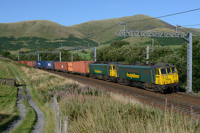 86609+86604 rush past Lowgill with the Coatbridge-Crewe liner 4/8/14.