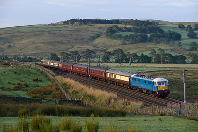 "86259 ""Les Ross"" hauls empty stock from Carnforth-Edinburgh past Greenholme at 06.33, 8/8/14."