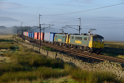 Running 3½ hours late after loco problems, a Felixstowe-Coatbridge train climbs Shap bank behind 86613 & 86614, 10/8/17.