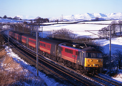 "86251 ""The Birmingham Post"" heads a northbound cross country service at Docker 30/12/00."