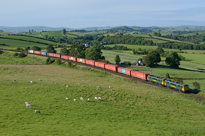 86628+86627 sweep round the curve at Hincaster with the evening liner train 9/7/15.