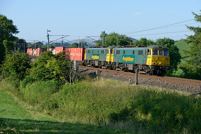 86610+86627 pass Hincaster with the evening liner 25/7/14.