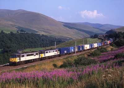 86611 + 86638 sweep through the Lune Gorge with a fully laden liner train 7/8/97.