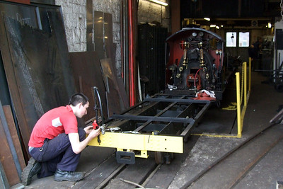 Ben Taylor works on the brake pipes of Wagon T, the tank wagon. Interestingly, this used to be the chassis of River Irt's old tender, so does not look as out-of-place behind the Irt as one might think, 03/04/08.