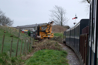 Shelagh of Eskdale returns to Ravenglass, passing Anita the flail mower on the headshunt at Raven Villa, 03/04/08.