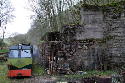 Shelagh of Eskdale is dwarfed by the ruins of Murthwaite crushing plant, 10/04/09.