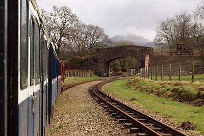 Douglas Ferreira approaches Irton Road, with Harter Fell crowning the bridge. 11//04/11.