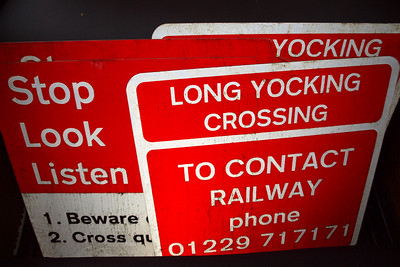Long Yocking Crossing's old signage in my brake van, having been replaced (yes, they only went up in summer 2007... but rules is rules!) 13/04/11.