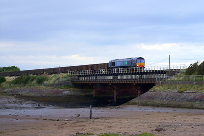 66415 leads a rake of JNA wagons across the Mite viaduct at Ravenglass, 03/08/09.