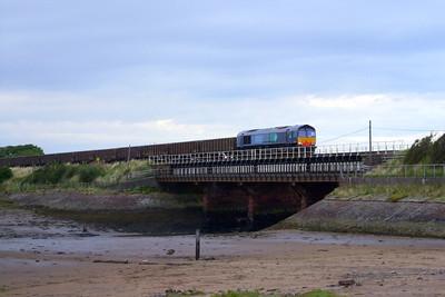66415 leads a rake of JNA wagons across the Mite viaduct at Ravenglass, 03/08/09.