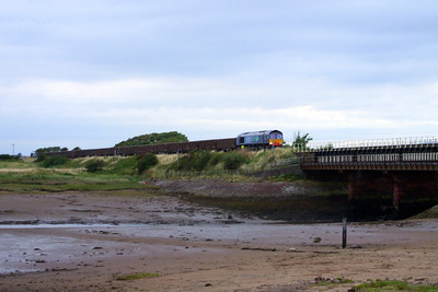 In fading light, 66415 and 66432 approach Ravenglass with 6C60 Sellafield - Millom JNA wagons, for loading with aggregate for the construction of Vault 9 at Drigg LLW Repository, 03/08/09.