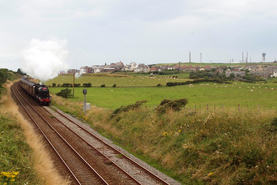 The village of Seascale, nestled under the chimneys of Sellafield, is awakened by 48151 heading south to Ravenglass with the ECS. 06/08/11.