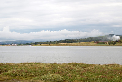 Looking across the River Esk estuary towards Ravenglass from Eskmeals, Newbiggin, as 48151 appears with The Lakelander. 06/08/11.