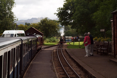 Waiting for a train - Douglas Ferreira sits in the up loop at Irton Road as River Esk approaches with the 1230 Dalegarth - Ravenglass. 05/08/11.