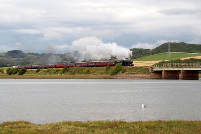 48151 heads south from Ravenglass with The Lakelander, seen here at Eskmeals, with Newtown Knott visible on the right. 06/08/11.