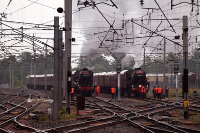 Two West Coast Railways-operated steam railtours sit in the Down & Up Goods Loops at Carnforth - on the left, 48151 with The Lakelander from Wolverhampton to Ravenglass and on the right, 45305 with The Cumbrian Mountain Express from Liverpool Lime Street to Carlisle. 06/08/11.