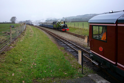 Boxing Day - River Irt draws into Irton Road with the busy nine-coach up train as Douglas Ferreira waits in the down loop, 26/12/06.