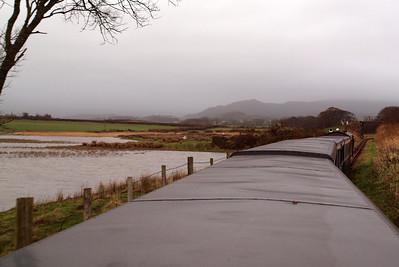 Flooded estuary of the River Mite as we head towards Black Bridge. Irton Pike is on the horizon. 26/12/11.