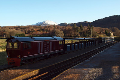 Douglas Ferreira with Harter Fell, covered in snow, on the skyline at Dalegarth. 18/12/11.