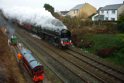 71000 Duke of Gloucester roars through Ravenglass on The Cumbrian Coast Pullman charter, as Douglas Ferreira, Flower of the Forest and Cyril sit on the headshunt to welcome her, 24/02/07.