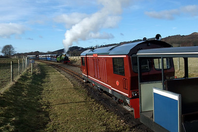 Douglas Ferreira sits in the loop at Irton Road as River Irt arrives with a Dalegarth-bound train. 13/02/10.