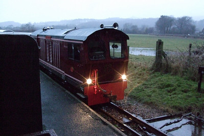 Douglas Ferreira, with headlights brightly shining, arrives at a very wet Irton Road, 01/01/08.
