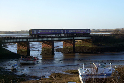 A Northern Rail Class 156 crosses the Mite viaduct at Ravenglass, 24/01/09.