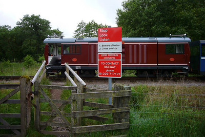 Douglas Ferreira pauses momentarily for a photo at the newly signposted Long Yocking footpath crossing, 17/06/07.