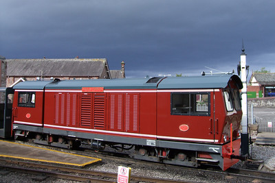 Douglas Ferreira sits under a dark sky out over the Irish Sea at Ravenglass, 06/06/09.