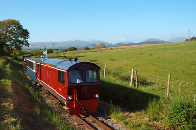 Douglas Ferreira with the 1740 Dalegarth - Ravenglass passes Raven Villa on the final approach into Ravenglass, the Western Lake District fells clearly visible on the horizon. 02/06/11.