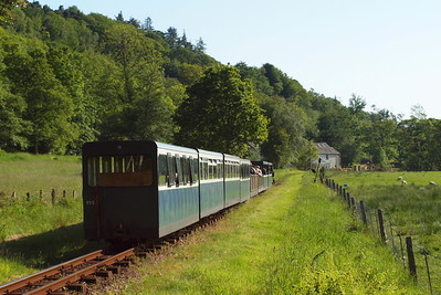 Northern Rock's train descends towards Muncaster Mill. 02/06/11.