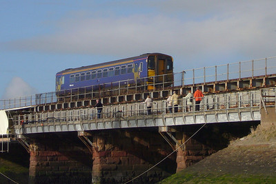 A Northern Rail Class 153 DMU in the old North West Trains livery crosses the Mite viaduct at Ravenglass, 03/03/07.