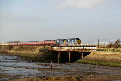 37667 and 37688 Kingmoor TMD cross the River Mite viaduct at Ravenglass with The Cumbrian Coast Explorer for Spitfire Railtours, bathed in glorious evening light, 08/03/08.